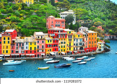 The beautiful Portofino with colorful houses and villas, luxury yachts and boats in little bay harbor. Liguria, Italy, Europe