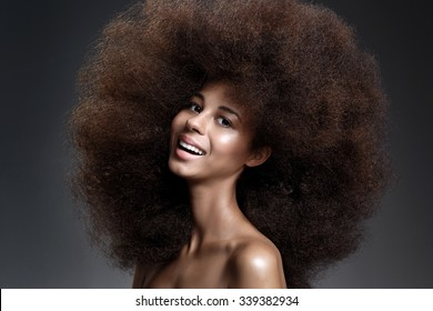 Beautiful Portrait of an African American Black Smiling Woman With Big Hair.
