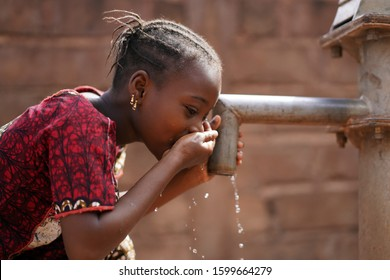 Beautiful Portrait of African Children Drinking Outdoors Fresh Water from tap
