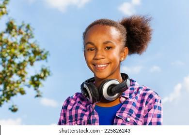 Beautiful portrait of African girl with headphones