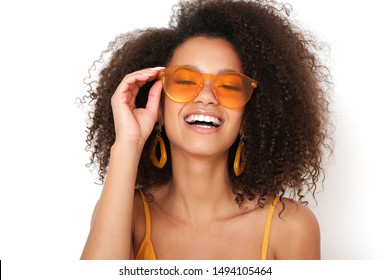 Beautiful portrait of afro-amercian girl in orange sunglasses.