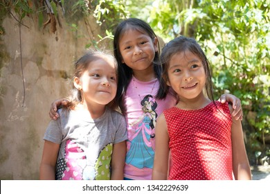 Beautiful Portrait Amazonian Native Group of Little Girls Smiling in Iquitos Tribes across Rio Negro, Amazon Rainforest. Iquitos, Amazon, Peru, March, 2019