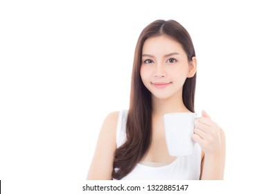 Beautiful portrait asian woman smiling and drinking water glass with fresh for diet, beauty girl thirsty and charm holding beverage with healthy isolated on white background, health care concept.