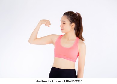 Beautiful portrait asian woman wear sport clothes have strong and muscle with health, girl show biceps with exercise and workout for wellness isolated on white background, strength and fit concept.