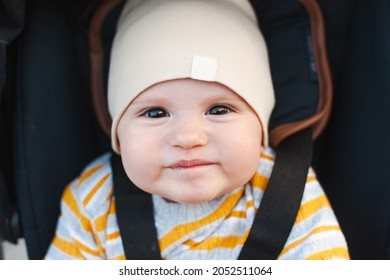 Beautiful portrait of a baby in carriage for lifestyle design. Funny happy baby. Baby care. Outdoor summer fun. Family day. Baby girl.