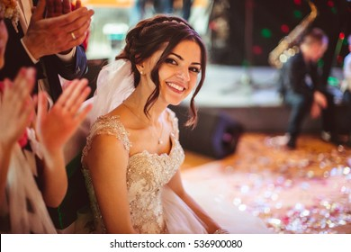 beautiful portrait of charming and young bride with curly hair