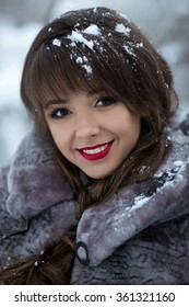 Beautiful portrait of cute,cutie,nice,adorable,delightful,beautiful,cheerful,smiling,happy,excited,natural girl with very,cute,white,healthy smile,dentist,cosmetics,makeup,ice,snow,snowflakes in hair.