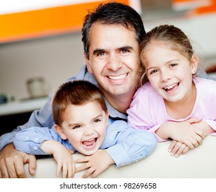 Beautiful portrait of a father with his to kids at home