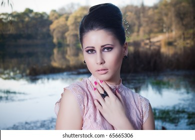 beautiful portrait of  girl in retro style at the background of the autumn nature