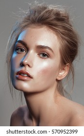 Beautiful portrait of a girl with wet make-up and shiny skin