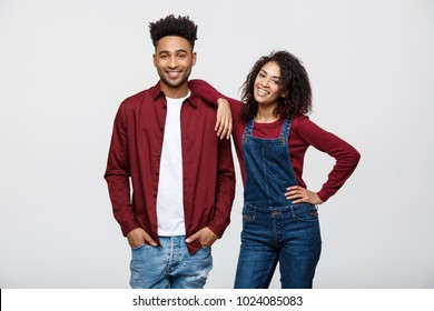 Beautiful portrait of a happy African American couple isolated over white