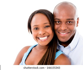 Beautiful portrait of a happy couple �¢?? isolated over white