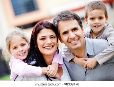 Beautiful portrait of a happy family smiling - outdoors