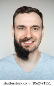 Beautiful portrait of a man teeth smile with a full beard and no beard after shaving with light stubble. Barber working on a white background.