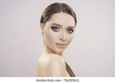 beautiful portrait with perfect fresh clean skin and make up in studio. high quality image.