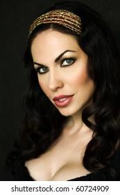 beautiful portrait of Russian brunette woman on black background