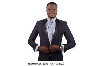 Beautiful portrait of smiling confident businessman in suit isolated on white background.