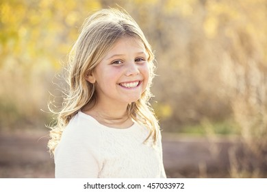 Beautiful Portrait of smiling little girl outdoors