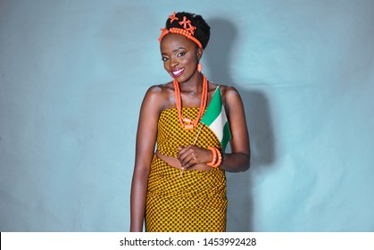Beautiful portrait of Traditional Igbo woman carrying a Nigerian flag