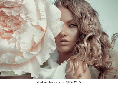 Beautiful portrait of a woman with big paper flowers - Shutterstock ID 788980177