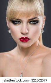 Beautiful portrait of a woman with fashion makeup