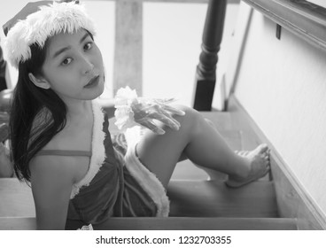Beautiful portrait of woman in Santa Claus concept