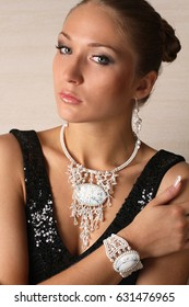 Beautiful portrait of woman with white jewelry