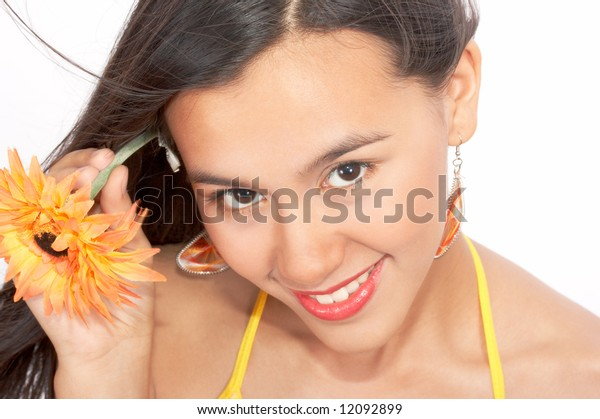 beautiful portrait of a woman with a yellow flower