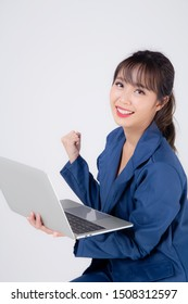 Beautiful portrait young asian business woman smiling and cheerful holding laptop computer isolated on white background, businesswoman using notebook, asia freelance girl work job success and excited.