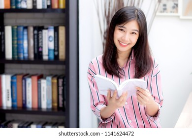 Beautiful of portrait young asian woman relax sitting reading book in living room at home, girl study literature, education and llifestyle concept.
