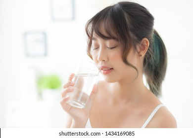 Beautiful portrait young asian woman caucasian smiling with nutrition thirsty and drinking glass of water mineral with fresh and happy, asia girl diet for healthy care and wellness, lifestyle concept.