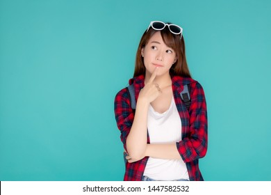 Beautiful portrait young asian woman wear sunglasses on head smile confident thinking and idea summer holiday isolated blue background, model girl fashion in vacation, travel concept.