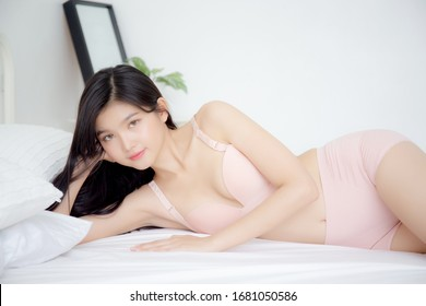 Beautiful portrait young asian woman sexy in underwear figure fit relax with seductive in bedroom, asia girl body slim in lingerie confident and happy lying on bed in bedchamber, lifestyle concept.