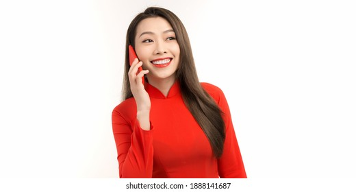 Beautiful of portrait young asian woman talk smart phone and smile standing on white background