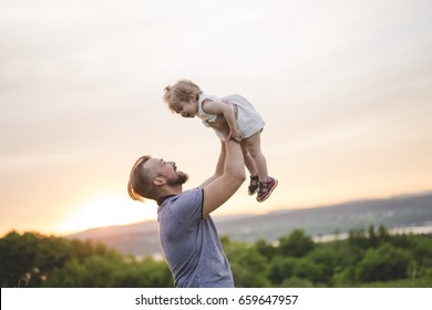 A Beautiful portrait of young attractive father with daughter toddler