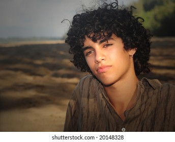 Beautiful portrait Of a Young Man at the beach