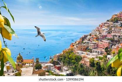 Beautiful Positano with comfortable beaches and azure sea on Amalfi Coast in Campania, Italy. Amalfi coast is popular travel and holyday destination in Europe. Ripe yellow lemons in foreground.