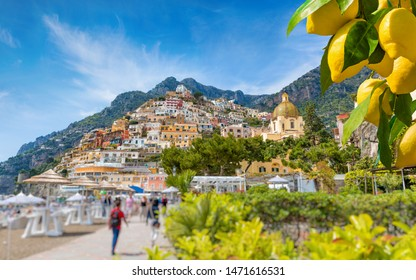 Beautiful Positano with comfortable beaches on Amalfi Coast in Campania, Italy. Amalfi coast is popular travel and holyday destination in Europe. Ripe yellow lemons in foreground.