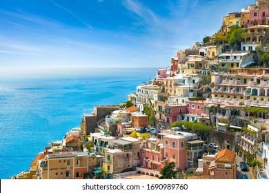 Beautiful Positano with hotels on hills leading down to coast, comfortable beaches and azure sea on Amalfi Coast in Campania, Italy. Amalfi coast is popular travel and holyday destination in Europe. - Shutterstock ID 1690989760