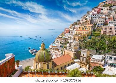 Beautiful Positano on hills leading down to coast, comfortable beaches and azure sea on Amalfi Coast in Campania, Italy. Amalfi coast is popular travel and holyday destination in Europe.