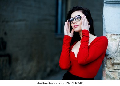 Beautiful positive fashionable stylish modern brunette girl in trendy glasses looking at camera. Portrait of smart, clever girl in glasses. Beautiful European girl with glasses.