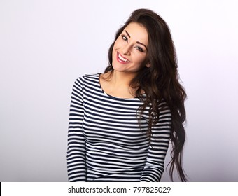Beautiful positive woman in stripped casual shirt with long hair toothy smile on white background. Closeup portrait
