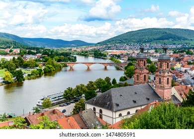 Beautiful postcard View from castle on old german town Miltenberg am Main river, St. Jacob catholic church, main bridge.     Odenwald, Bavaria, Germany