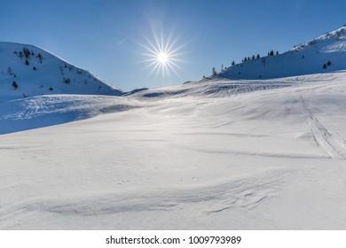 beautiful postcard winter nature view near artificial lake of Sauris (Lago di Sauris) in Friuli Venezia Giulia, Udine, Italy, Europe