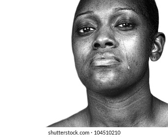 Beautiful Powerful Image of a Black woman Crying isolated on white