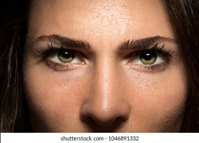 Beautiful and powerful intense staring eyes of confidence and courage in female close up