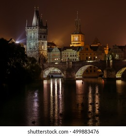 beautiful Prague at night with Charles bridge and theater
