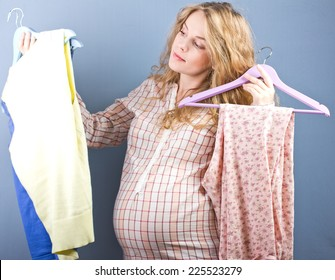 Beautiful pregnant blonde chooses clothes. Portrait of pregnant woman. fashion portrait.woman couple shopping portrait.