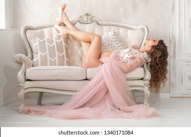 beautiful pregnant girl lies on a gorgeous couch