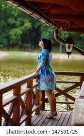 beautiful pregnant girl on the lake